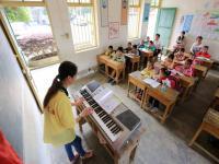 如何让孩子们在音乐教育的影响下全面、和谐的成长
